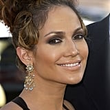 Since the start of her career, J Lo has been fond of coordinating her lip color to her complexion. At the premiere of Gigli in 2003, she wore this shiny peachy shade.