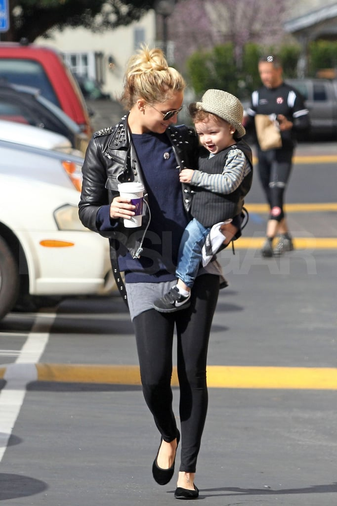 Nicole Richie stuck with her love of leather this morning to grab coffee in LA with her son Sparrow. Sparrow wasn't about to let his mother steal the fashion limelight, as he was also dressed to impress in a little vest and cap. Nicole has been brushing up her own style skills lately as she debuted her new Winter Kate and House of Harlow 1960 collections with a party in NYC and a bash on Long Island. She managed to find time to join the ladies on The View for a chat yesterday, but we're especially excited to find out what Nicole has up her sleeves when it comes to her collaboration with Tracy Anderson.