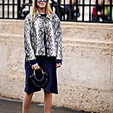 Style your minimalist sandals with a snakeskin-print jacket and navy dress.