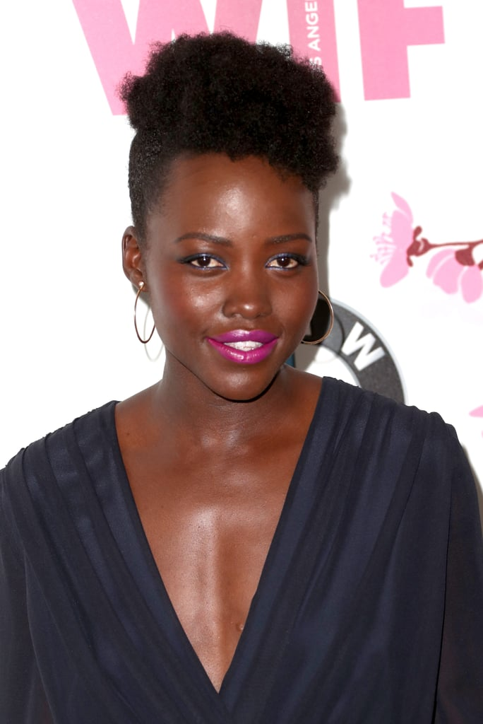 """First Lancome memory:  """"Using one of its blushes for my first big red carpet at the Toronto Film Festival. I just remember thinking, 'Wow.' Blush can often be a rather foreign idea for dark skin. It can also look kind of contrived or forced, because we don't blush naturally. It gave a rosiness, a warmth, to my face without being too obvious or too conspicuous, and I liked that.""""  Specific colour recommendations for wearing blush if you have a deeper skin tone? """"I would say that you want to go with the plumier colours more so than the peachier colours. It just needs to be a little deeper."""" What inspires her bold-coloured makeup choices on the red carpet? """"I want to have fun, and I am lucky enough to get to play dress-up very often. It's a moment of experimentation and of whimsy and fantasy, really. And I just like to embrace that."""""""