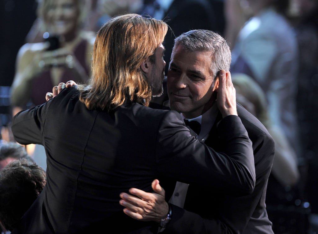 Brad Pitt embraced his pal George Clooney at the Critics' Choice Awards in January 2012.