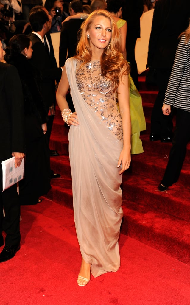 Wearing a Chanel beige tulle paillette embroidered dress to the 2011 Met Gala.
