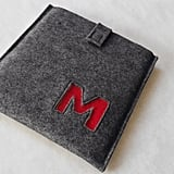 Everyone loves their new gadgets — gift your guy the perfect case for his techie gear, one with his own initial (so you know it's his).  Custom Monogram iPad Sleeve ($49)