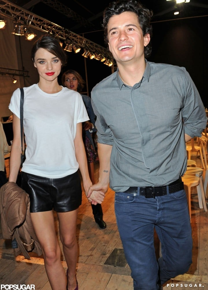 Orlando Bloom and Miranda Kerr held hands leaving the Christian Dior Spring/Summer 2012 Ready-to-Wear Paris Fashion Week show in September 2011.