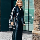 Wear a long leather trench coat, cinched at the waist, with metallic shoes. If it's cold at your destination, you won't even have to take off your outerwear.