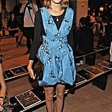 We love how her bow-adorned pumps sweeten the vibe of her Proenza Schouler floral-print frock.