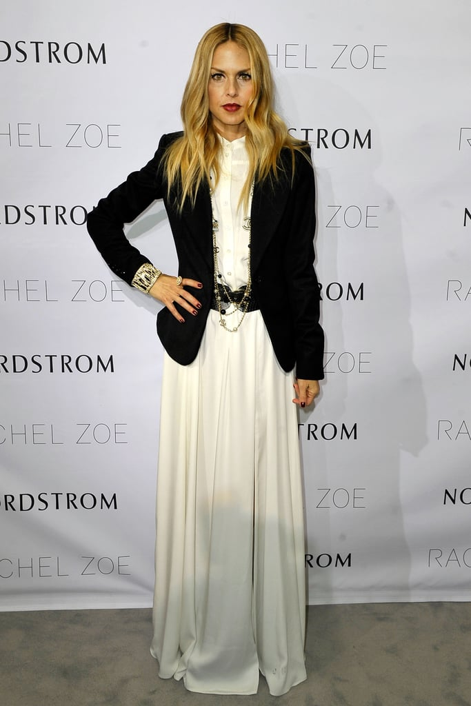 "Rachel Zoe was Winter chic in a white maxi and blazer at the presentation of her Spring 2012 collection at Nordstrom in San Diego last night. It was her second fashionable appearance this week after she launched the ZOE Media Group in LA on Wednesday. Rachel upped the glam factor at that event when she hit the red carpet in a sequin YSL jumpsuit with husband Rodger Berman by her side. We chatted with the stylist about her festive dressing tips, and she shared an update on her son, Skyler, saying that he gets his ""flippy"" hair from Rodger. Despite his wild locks, the little guy was one of the most adorable new babies of the year along with Flynn Bloom, Willow Hart, and others."