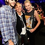 Ellen DeGeneres and Portia de Rossi with Ashton Kutcher.