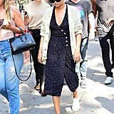 Take direction from Selena Gomez, who clearly pulled a Monica with this outfit choice. She took a simple patterned-dress — which is dainty and fresh — and paired it with a cream cardigan and white sneakers for an easy, everyday wardrobe choice.
