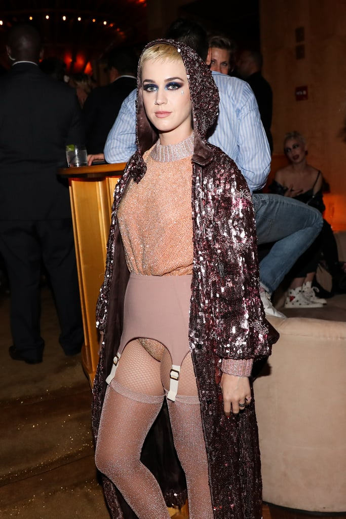 "We don't think we'll ever be able to forget Katy Perry's 2017 Met Gala ensemble. Simply put, the custom Maison Margiela Artisanal outfit was both mesmerizing and bewildering — making her Ulyana Sergeenko afterparty outfit look a little more understated in comparison. That being said, the ""Bon Appétit"" singer still wore a sequined leotard, glittery tights, a garter belt, and a sequined cape.  Following the Met Gala on May 1, Katy arrived at her afterparty at the Boom Boom Room in the Standard Hotel alongside friends Margot and Mia Moretti. The whole getup — namely the cape — actually reminded us of her 2013 Video Music Awards performance, wherein she performed ""Roar"" in a boxing ring. While it may have been a nod to that memorable performance, she might have also wanted to just slip into something a little more comfortable.       Related:                                                                                                           The Best Met Gala Looks From 2017 Will Get You Ready For This Year's Red Carpet"