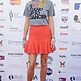 Never has a t-shirt looked so cool! The actress paired her printed separate with a flared coral skirt and animal-print Giuseppe Zanotti platforms at a Stand Up to Cancer event in LA.
