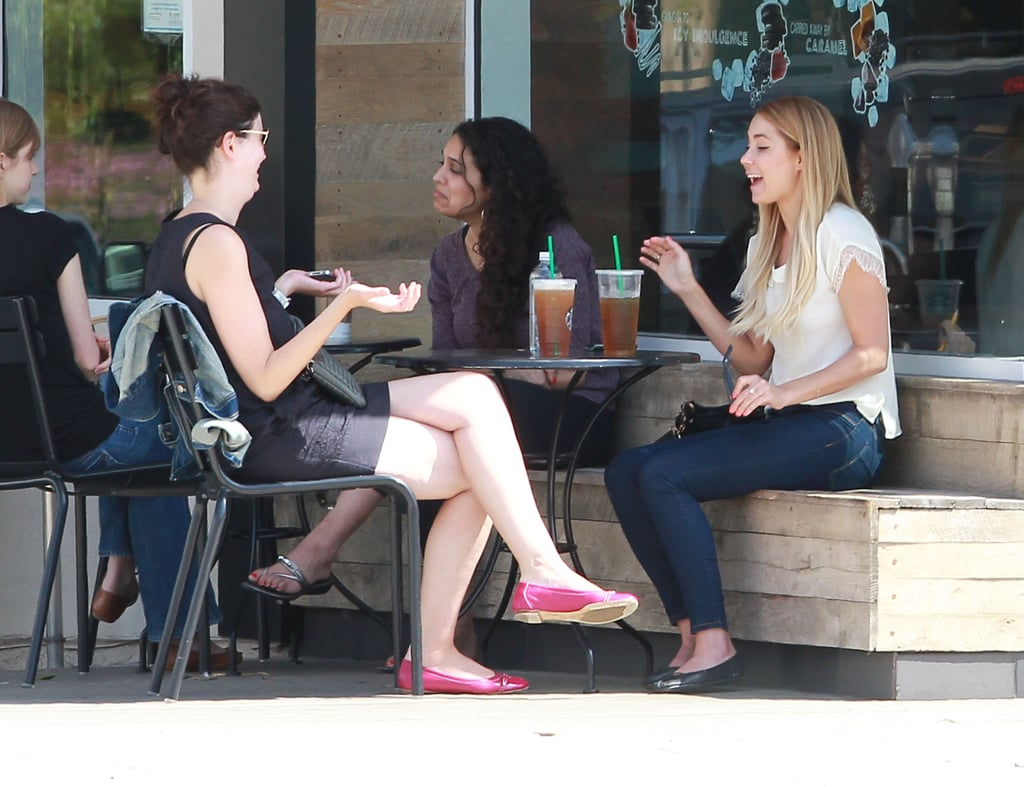 Lauren Conrad and a friend chatted at a table outside of Starbucks in LA.