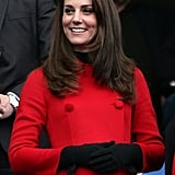During the RBS Six Nations match between France and Wales, Kate Middleton watched the game while bundled up in a red Carolina Herrera coat. She took a style cue from the Fall '17 runways, choosing black gloves as her main accessory.