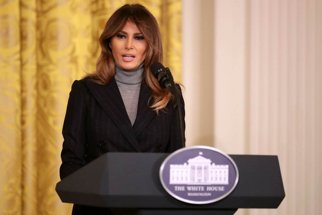 Melania Trump delivered a speech about the ongoing opioid crisis at a White House summit on March 1. For the event, she discussed the administration's work to combat the issue while wearing a polished outfit: a navy, double-breasted pinstripe suit. Rather than styling her suit with a blouse or a button-down shirt, Melania decided to take a styling cue from Steve Jobs and wear a turtleneck sweater underneath. The first lady wore a similar suit in grey while welcoming Canada's Prime Minister Justin Trudeau and his wife, Sophie, to the White House back in October. Read on to get a closer look at Melania's outfit, then shop similar sweaters ahead.      Related:                                                                                                           The 1 Accessory Melania Trump Wears From A.M. to P.M. — No Questions Asked