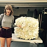 Taylor Swift and Kanye West proving that bad blood and VMA interruptions can be forgotten through flowers.