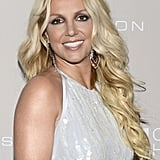 Britney Spears wore loose hair and statement earrings at the gala in LA.