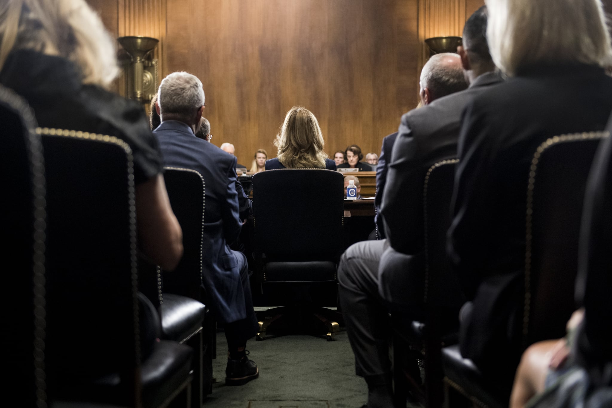 WASHINGTON, DC - SEPTEMBER 27: Dr. Christine Blasey Ford (C) takes her seat to testify on Capitol Hill September 27, 2018 in Washington, DC. A professor at Palo Alto University and a research psychologist at the Stanford University School of Medicine, Ford has accused Supreme Court nominee Judge Brett Kavanaugh of sexually assaulting her during a party in 1982 when they were high school students in suburban Maryland. (Photo By Tom Williams-Pool/Getty Images)