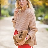 Match your luxe neutral tones with a camel-colored shearling bag, worn at the same time as your most cozy camel knits.