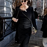 Olivia Palermo looked perfectly poised in black while running from show to show.