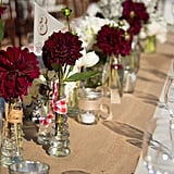 Place single stemmed flowers on a burlap table runner.