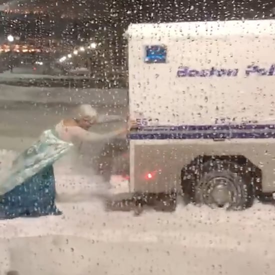 Man Dressed as Elsa Pushing a Van Out of a Snowbank