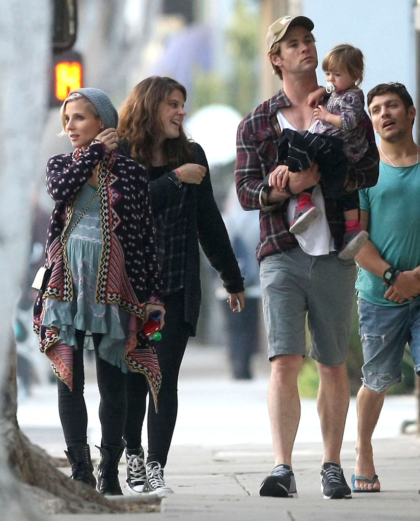 Chris Hemsworth and pregnant Elsa Pataky took their adorable daughter, India, out for a stroll in Venice Beach, CA, on Wednesday. Chris carried and kissed his little one while the couple visited various stores, including a surf shop where the Aussie actor checked out a board. Chris is back in LA after traveling to Elsa's native Spain with his growing family to film In the Heart of the Sea in November. He will soon be back on the move again, as he is scheduled to shoot the highly anticipated Avengers sequel in London very soon. The Hemsworth-Pataky family should be comfortable in London by now, as they have spent the past few years in England while Chris has shot various movies in UK, including Thor: The Dark World and Rush.