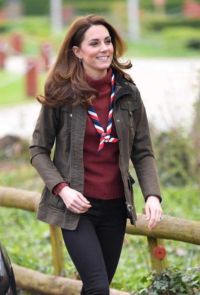 The Duchess of Cambridge paid a visit to Gilwell Park, the Scout Association's UK headquarters, where she found out more about a pilot program designed to introduce younger children to the Scouting movement. Kate, who has volunteered as a Scout leader in the past, looked totally at home as she sported her Scout's scarf and participated in some activities with some of the young children involved in the program.  Since she was going to be working outside, Kate dressed for the occasion in a casual outfit consisting of a khaki utility jacket over a J.Crew sweater and skinny jeans. The best news? Her sweater is on sale for only $50, making this a royal look you can definitely re-create. She finished the look with hoop earrings and her See by Chloé lace-up ankle boots, which she first wore in January on a similar outdoorsy adventure. Take a closer look at the entire outfit ahead, then shop that sweater for yourself.      Related:                                                                                                           Kate Middleton's Cable-Knit Sweater Is Basically the Definition of Preppy