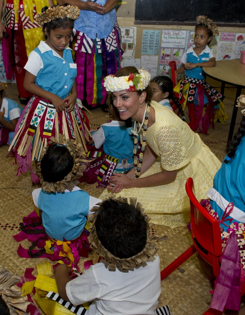 Kate Middleton was happy to sit on the floor and play with a group of kids at the Nauti Primary School in Tuvalu. She even got decked out in the locals' tradition garb during the couple's Diamond Jubilee tour stop in September 2012.