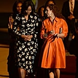 Michelle Obama touched down in Marrakesh in a floral Proenza Schouler wrap dress.