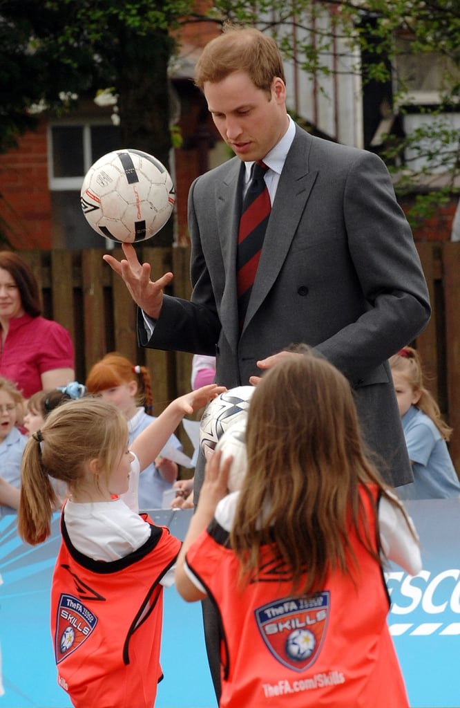 Prince William talked soccer with a group of children at St. Aidan's School in Blackburn, England, in May 2008.