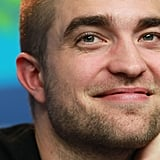 Robert Pattinson smiled at a press conference.