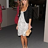 Giving a soft minidress her signature styling treatment with open-toe booties and an evening jacket at Fashion Week in September '08.