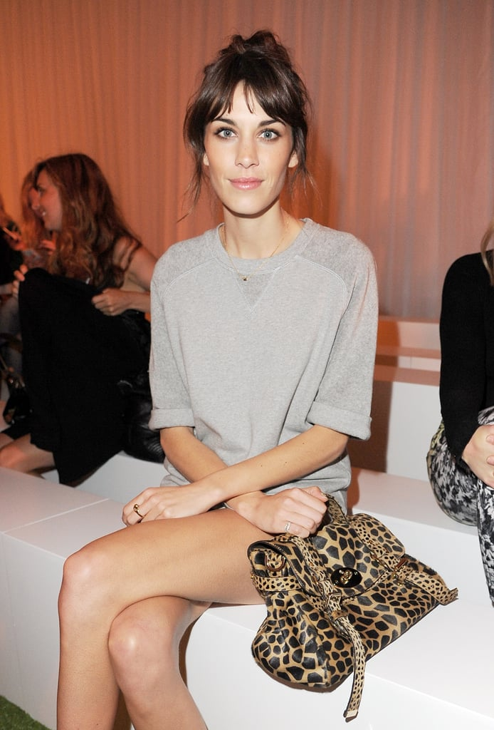 Alexa Chung carried a leopard-print bag to the Mulberry show.