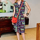 Elizabeth Banks punched up a bold printed sheath with a cherry-red crossbody bag.