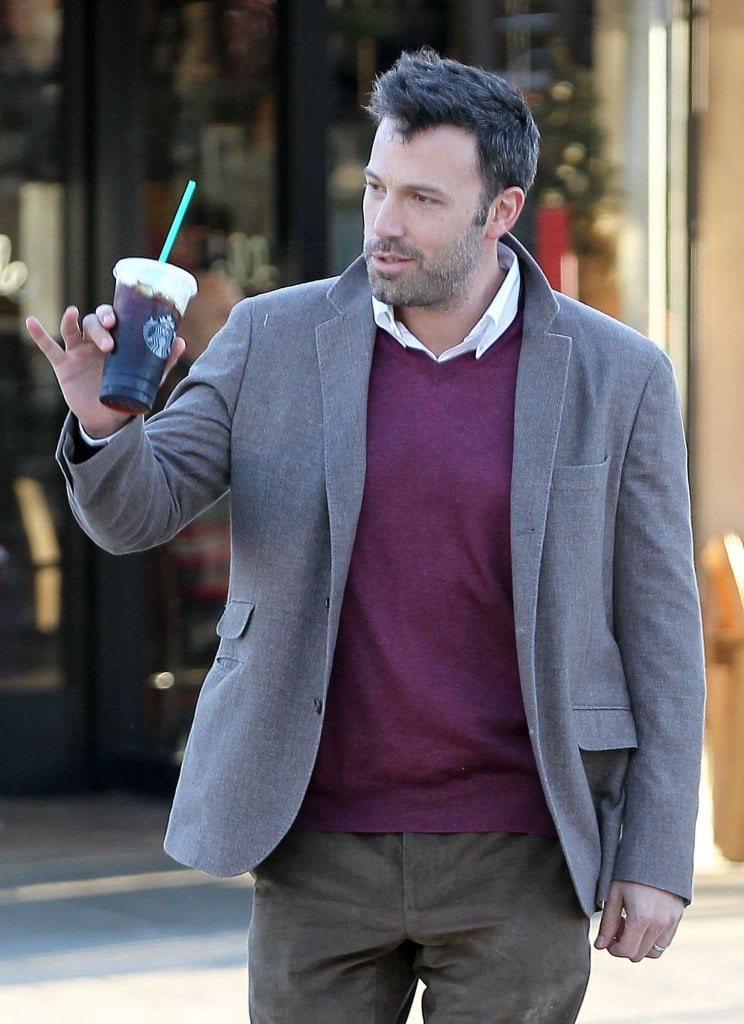 Ben Affleck said hi to someone as he walked across a street.