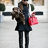 19. Layer a white shirt under a black pinafore dress for preppy polish.