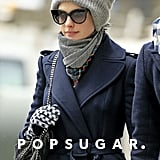 Anne Hathaway kept warm in a matching gray scarf and beanie.