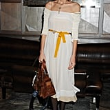 Alexa Chung wore a white dress whilst carrying a Mulberry Roxanne bag.