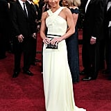 Kelly Ripa showed off her toned arms in a Carolina Herrera halter neck white gown with a double-wrapped black belt and matching clutch.