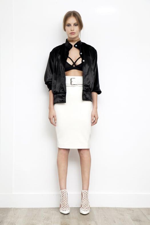 Viscose Sports Bra in Black, Panne Velvet Bomber Jacket in Black, Leather Slim Skirt in Cream, Secret Place Patent Mesh Sandal Bootie in Cream. Photo courtesy of Tamara Mellon
