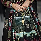 Anna Dello Russo's dark add-ons practically blend with her showstopping dress.