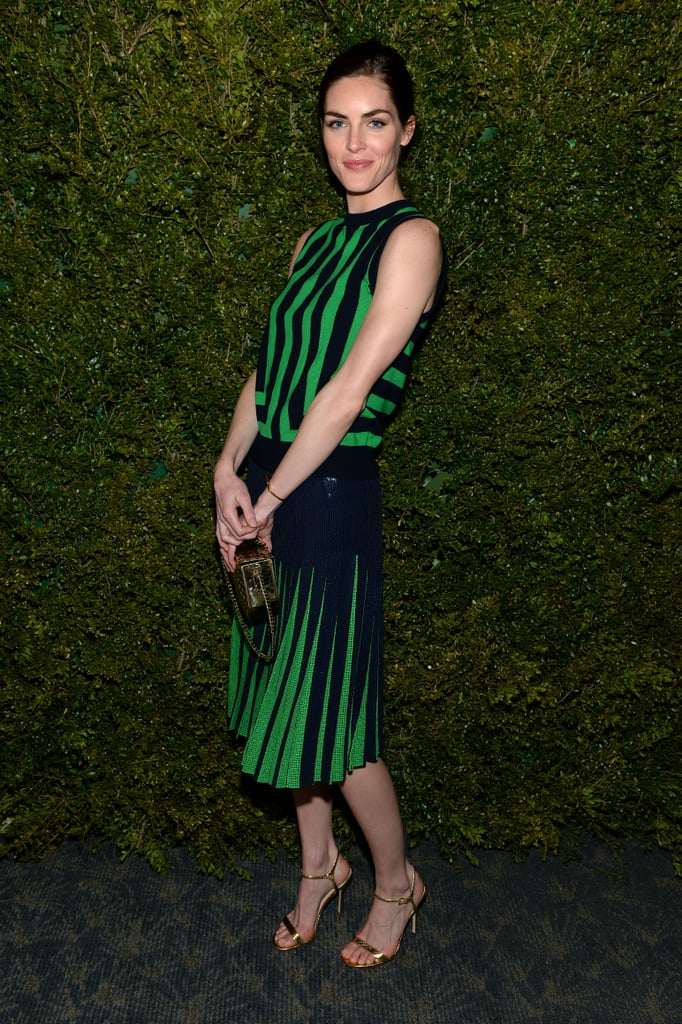Hilary Rhoda showed off her stripes in a Michael Kors black-and-green striped top, pleated sequined skirt, gold sandals, and matching metallic clutch.