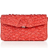 A go-with-everything statement clutch to pair with LBDs and printed maxis.  Alexander Wang Quillon Long Compact With Rhodium Hardware ($220, originally $315)
