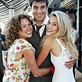 Rachael hugged it out with Jody Kennedy and Reshad Strik at the Channel Seven cocktail party in Dec. 2005.