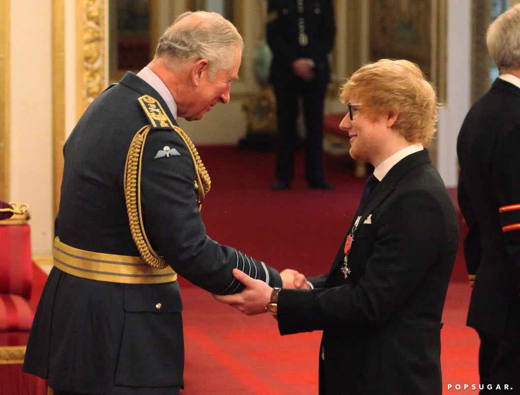"""A trip to Buckingham Palace meant Ed Sheeran finally had to ditch his usual t-shirt and jeans for something a little more fitting. Ed is known for hitting even the most glamorous red carpet in casual threads, but for his investiture service on Thursday, he followed the strict dress code, sporting a sharp suit for his big moment. He officially became Ed Sheeran, MBE, as Prince Charles awarded him the honor for his services to music and charity. Despite dressing the part, Ed still managed to break royal protocol when he grabbed Charles's arm instead of shaking his hand. The monarchy suggests that you shouldn't go beyond a handshake when meeting a British royal, but Charles certainly didn't seem to mind the incident. The royal family gives out an MBE — a very prestigious award which stands for Member of the Most Excellent Order of the British Empire — to an individual for some sort of outstanding service. Ed joins a whole host of famous faces who've been honored this year. Last month, Julie Walters became a dame and Helen McCrory received an OBE from the Queen, while Victoria Beckham picked up her OBE from Prince William back in April. Other stars honored in 2017 include Naomie Harris, Billy Connolly, and Anna Wintour.      Related:                                                                                                           23 Times Ed Sheeran Redefined the Term """"Work Hard, Play Hard"""" in 2017"""
