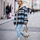 Style a Shearling-Lined Coat With Skinny Jeans and White Boots