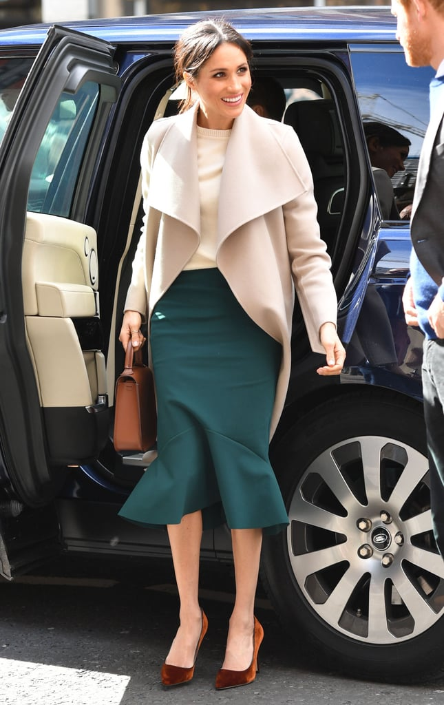 For a trip to Belfast, Northern Ireland, Meghan Markle kept to a simple palette of cream and brown neutrals. She wore a belted wool coat by Mackage, a Victoria Beckham sweater, and a Greta Constantine skirt.