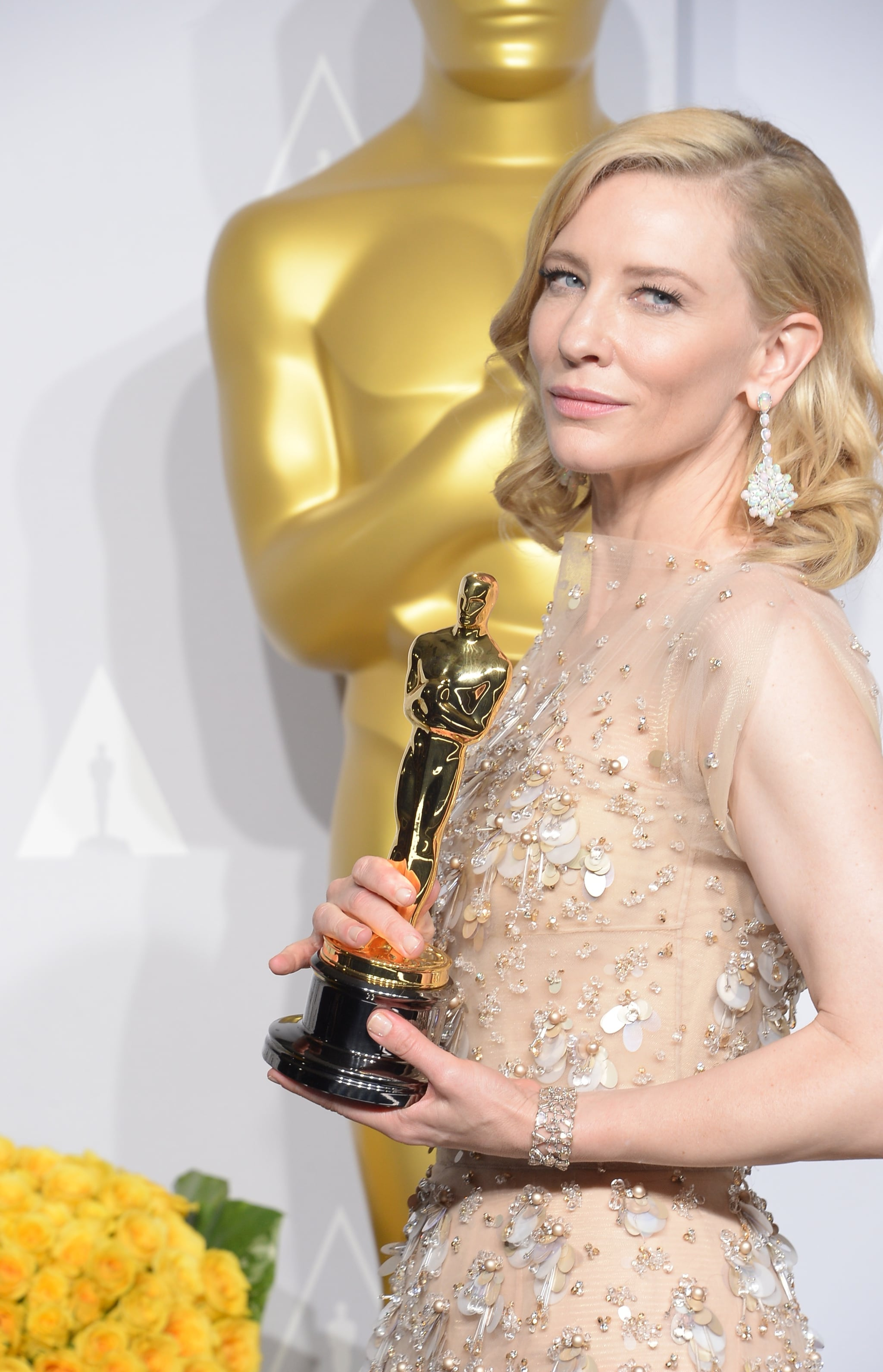 Cate Blanchett struck a pose with her best actress Academy Award for Blue Jasmine.