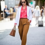 Style a Simple Pair With Trousers With a Pink Blouse and White Blazer