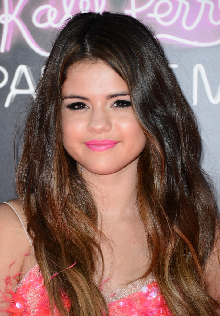 Selena has gradually lightened up her dark brunette hair over the years, and at the Katy Perry: Part of Me premiere, she added a touch of honey highlights to her look.